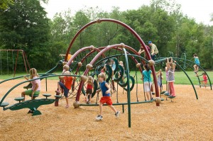 Safest playground surfaces are sand, wood chips or synthetic material